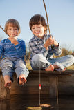 Happy boys go fishing on the river, Two children of the fisherma Stock Photography