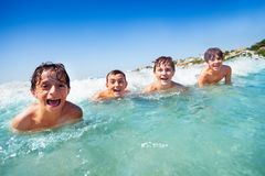 Happy boys having fun while swimming in the sea royalty free stock images