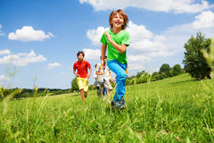 Happy boys play and run outside Royalty Free Stock Photo