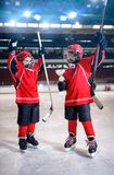 Happy boys players ice hockey winner trophy stock images