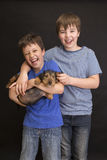 Happy boys portrait, the brothers and the dog. Stock Photo