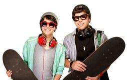 Happy boys with skateboards Royalty Free Stock Photos