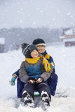 Happy boys on sled Royalty Free Stock Images