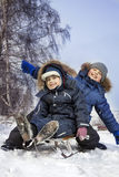 happy boys on sled Stock Images