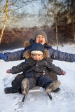 Happy boys on sled royalty free stock image