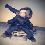 Happy boys on sled Stock Photos