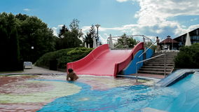 Happy boys on slide in the summer Stock Photos