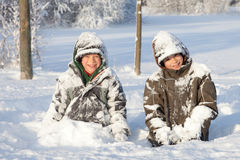 Happy boys in snow Royalty Free Stock Photography