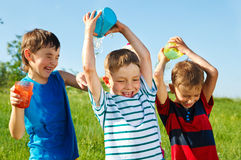 Happy boys splashing water Royalty Free Stock Photos