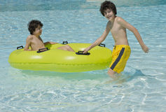 Happy Boys  are  in the Swimming Pool Stock Photography