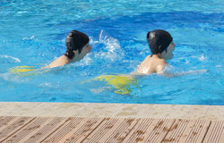 Happy Boys  are  in the Swimming Pool Royalty Free Stock Photo
