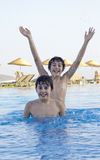 Happy boys  in the swimming pool Stock Photos