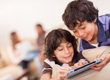 Happy boys with a tablet Royalty Free Stock Photos
