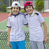 Happy boys are  in the tennis court Royalty Free Stock Photography