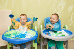 Happy boys twins draws Royalty Free Stock Photography
