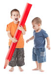 Happy boys whit large pencil Royalty Free Stock Photo