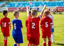 Happy Boys Winning Soccer Match. Young Successful Soccer Football team. Happy Boys Winning Soccer Match. Young Successful Soccer Football Players on the Pitch royalty free stock images