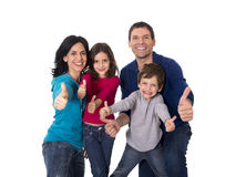 Happy Brazilian family mother and father playing with little son and daughter having fun Stock Image