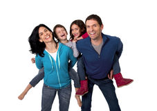 Happy Brazilian family mother and father playing with little son and daughter having fun Royalty Free Stock Images