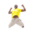 Happy brazilian football fan jumping up Stock Photography