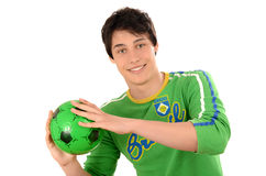 Happy Brazilian man catching a football ball. Stock Images