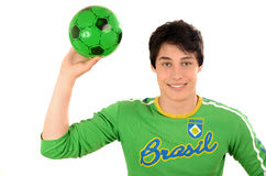 Happy Brazilian man with a football ball in the hands. Royalty Free Stock Photo