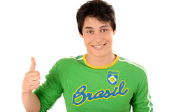 Happy Brazilian man signing thumbs up for Brazil. Royalty Free Stock Images