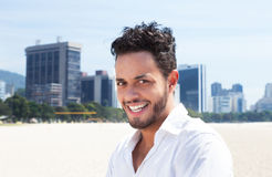 Happy brazilian man with skyline in the background Stock Photos