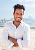 Happy brazilian man standing at Copacabana beach Royalty Free Stock Images