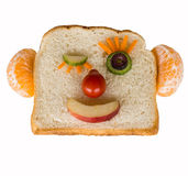 Happy bread face isolated. Funny winking face made from bread, fruit and vegetables Royalty Free Stock Photo