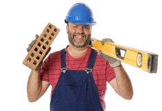 A Happy Brick Layer. A real worker with a cheerful and positive attitude, isolated on white Royalty Free Stock Photo