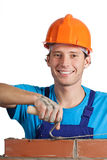 Happy bricklayer working Stock Images