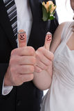 Happy bridal pair with thumbs up. Lucky couple get married. Royalty Free Stock Images
