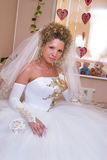 Happy bride. Young happy bride waiting for her groom in the room Royalty Free Stock Images