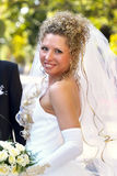 Happy bride. Young happy bride smiling in the park Royalty Free Stock Photography