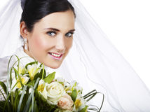 Happy bride. Portrait of happy bride with flowers Royalty Free Stock Images