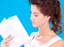 Happy bride. With money in envelopes over blue royalty free stock photo