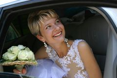 Happy bride. The laughing bride in the car Stock Images