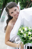 Happy bride. Smiling and back of her groom royalty free stock photography