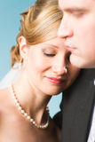 Happy bride. Leaning on groom's shoulder, looks down stock photos
