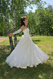 Happy Bride. Bride dances on lawn in park Royalty Free Stock Images