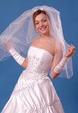 Happy bride. Young beautiful bride holding a veil Royalty Free Stock Images