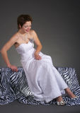 Happy bride. Adjust her dress Royalty Free Stock Photo