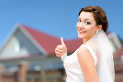 Happy bride against her house Royalty Free Stock Photo