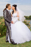 Happy Bride And Groom Against Blue Sky Royalty Free Stock Image
