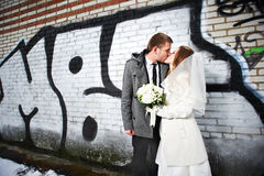 Happy Bride And Groom Kissing Near Graffiti Royalty Free Stock Photos