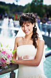 Happy bride on background of fountain Royalty Free Stock Photo