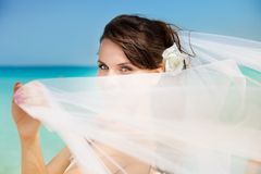 Bride on the beach with white veil Royalty Free Stock Photography