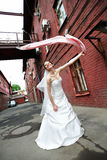 Happy bride on background of old red building stock image