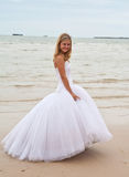 Happy bride on a beach stock photos